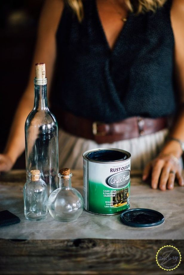A blogger dips a glass bottle into black paint\u2014look at her
