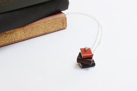 Leather Pile of Books Necklace- Miniature Handcrafted Orange, Brown & Black Book Stack Leather Books Necklace - OOAK. https://www.etsy.com/nz/shop/ExLibrisJewellery
