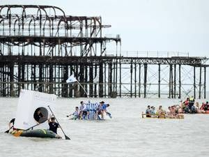 Competitors take part in the 'Paddle Something Unusual' event at the Paddle Round The Pier Beach Festival in Brighton