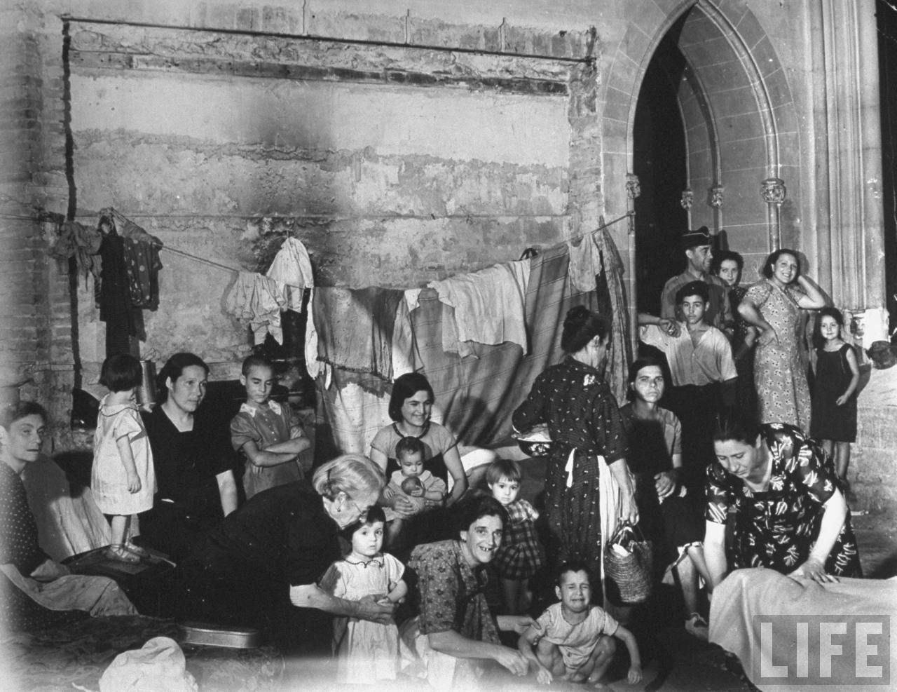People taking refuge in a church in Barcelona in a an air raid during the Spanish Civil War