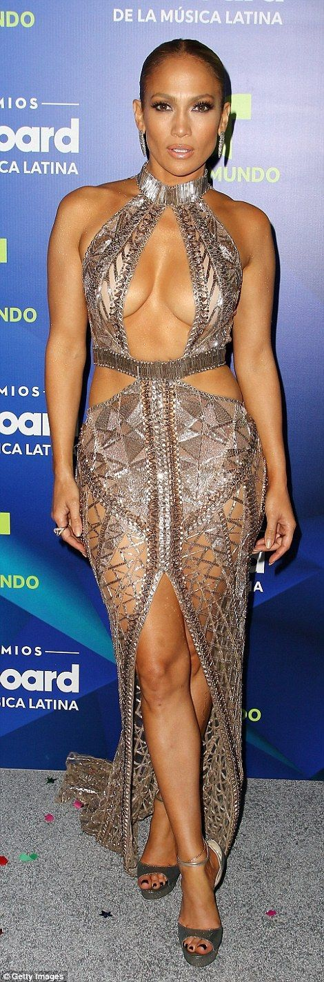 d96f044a89b The 47-year-old singer dared to bare Thursday in a revealing fishnet dress  at the Billboard Latin Music Awards in Florida.