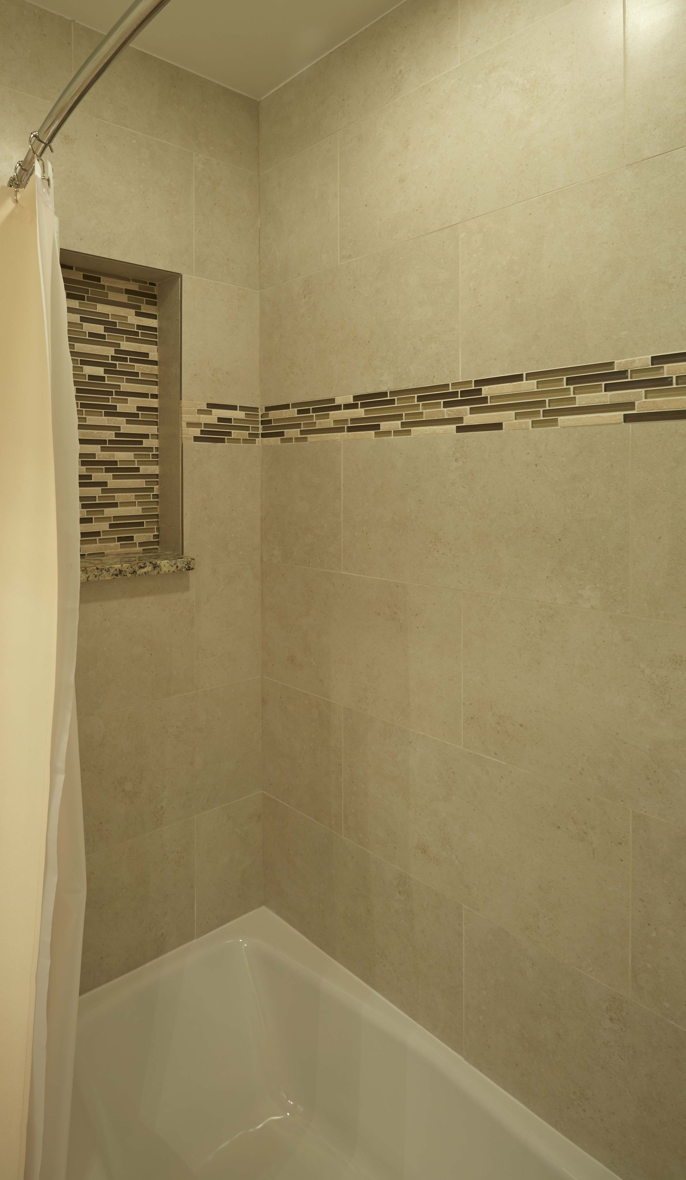 kohler villager bathtub eleganza wall tile and accent strip gatco curved shower rod