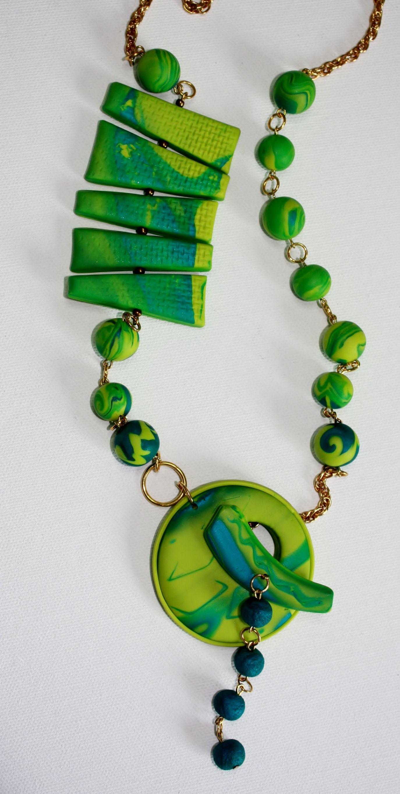 Polymer Clay Beads by Lyn Tremblay - Great fresh colour combo in this lariat-style necklace. Mokume Gane pendant toggle and bar beads balance well with each other.