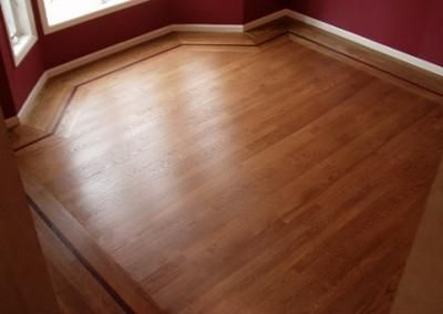 the best wood floor stain color for this room had to work with white enamel trim burgundy walls and a dark honey tone upright piano removing the