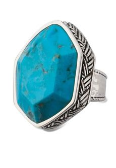 "Bansela Wild & Free Genuine Turquoise Ring... Do you love big rings? So do we! A large chunk of faceted freeform genuine turquoise set in woven silver overlay with a smoothly hammered band. Stone is 1.2"" x 1.5""."