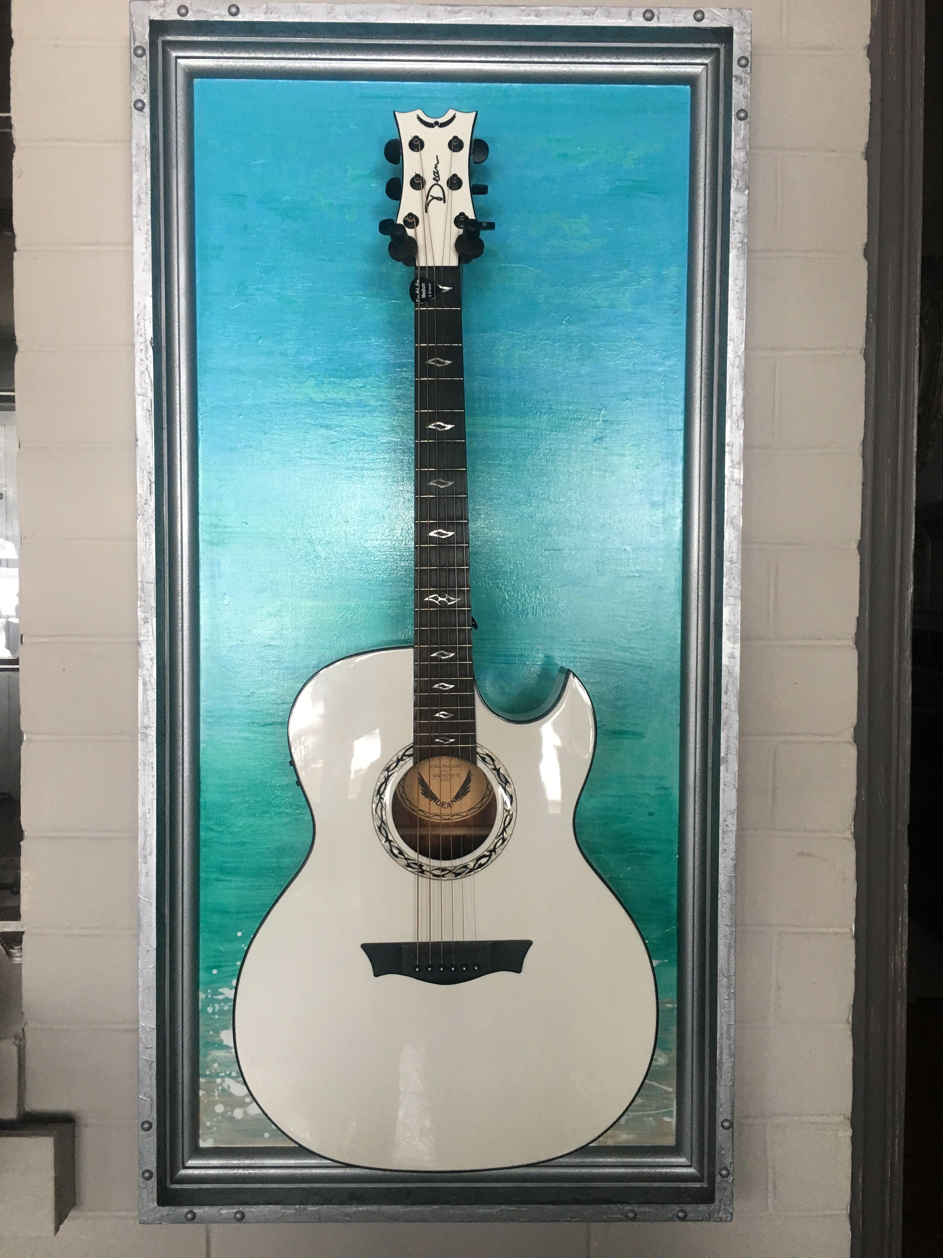 how high to hang guitar on wall