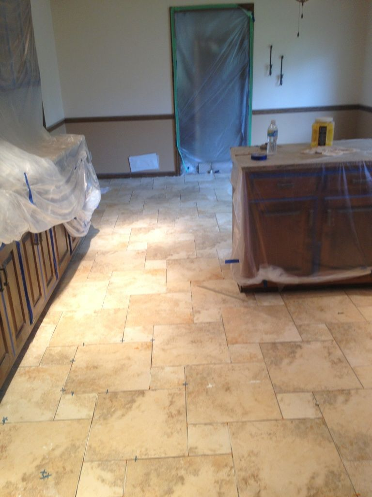 Porcelain tile, 2 sizes, installed in a pinwheel pattern. (Not grouted yet