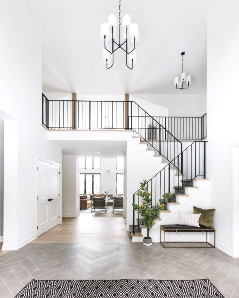 Staircase inspiration from LeClair Decor. Our stairwell is very 90's and in need of an update. Here's my plan to upgrade the wood to metal stair railings for a sleek look. Come see my metal staircase inspiration! #stairwell #metalrailings #stairs #staircase #runner #spindles