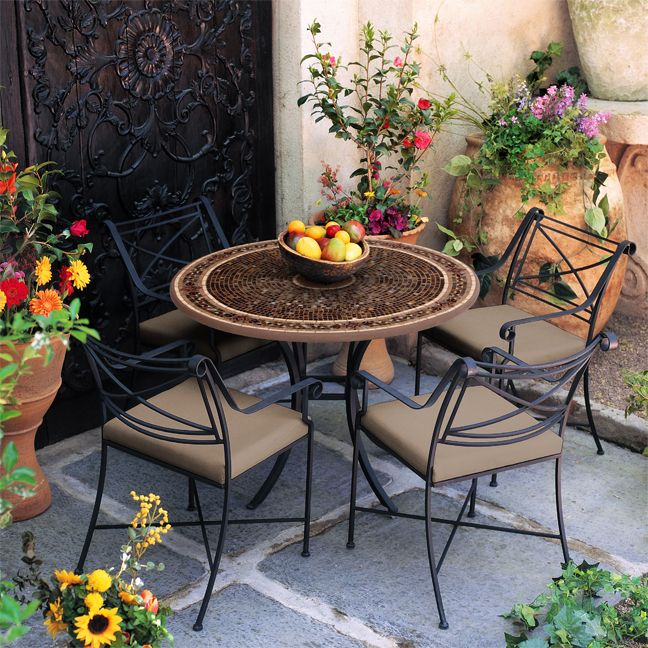 this iron mosaic patio set is perfect for an outdoor tuscany style