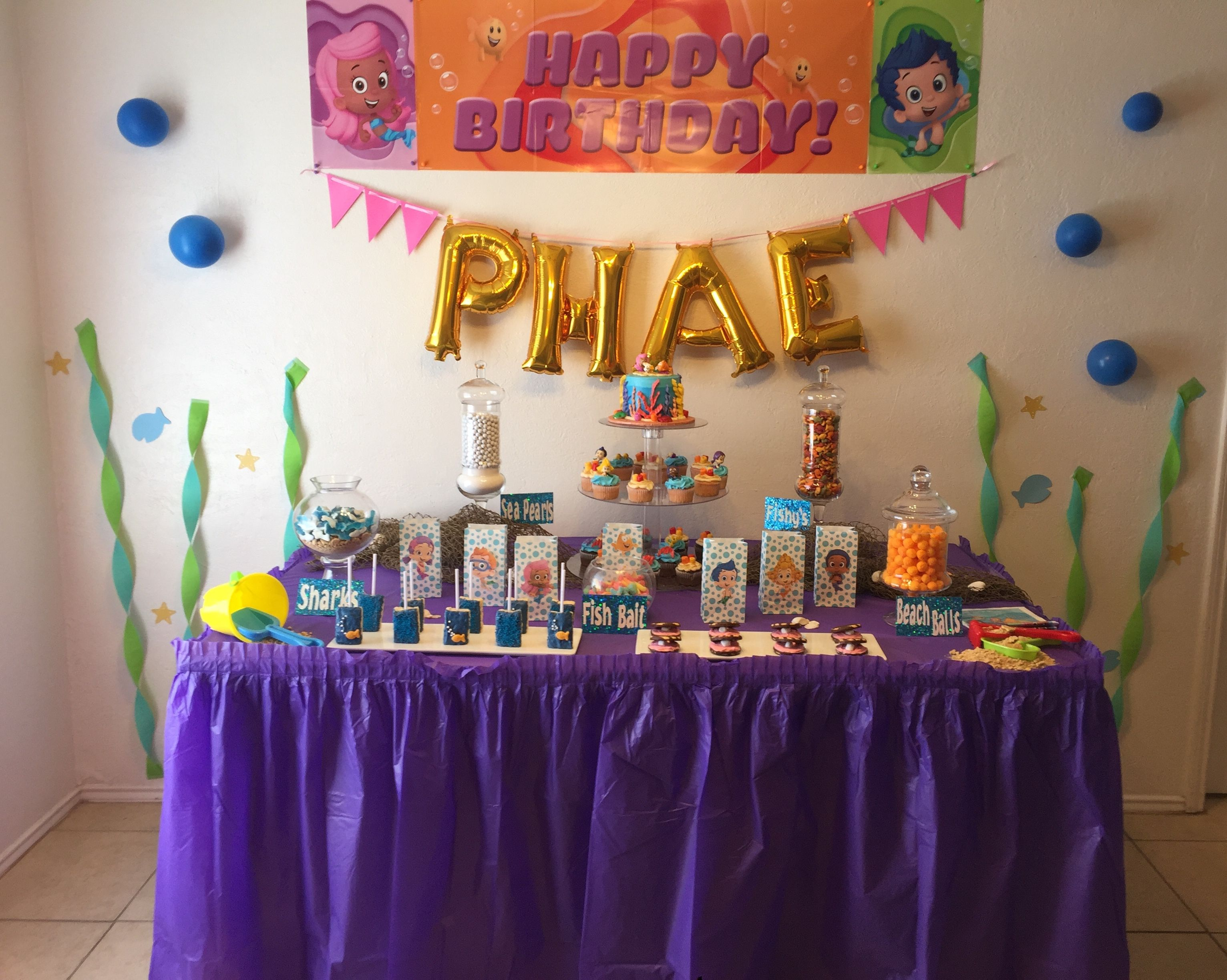 Bubble guppies candy table Baby birthday photo, Candy