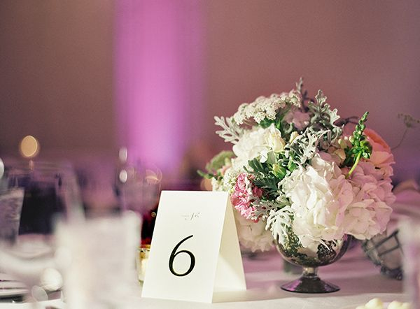 Dusty miller and hydrangea centerpiece with tent table number cards | photography by / & Elegant + Modern Chicago Wedding | Table numbers Tents and Dusty ...