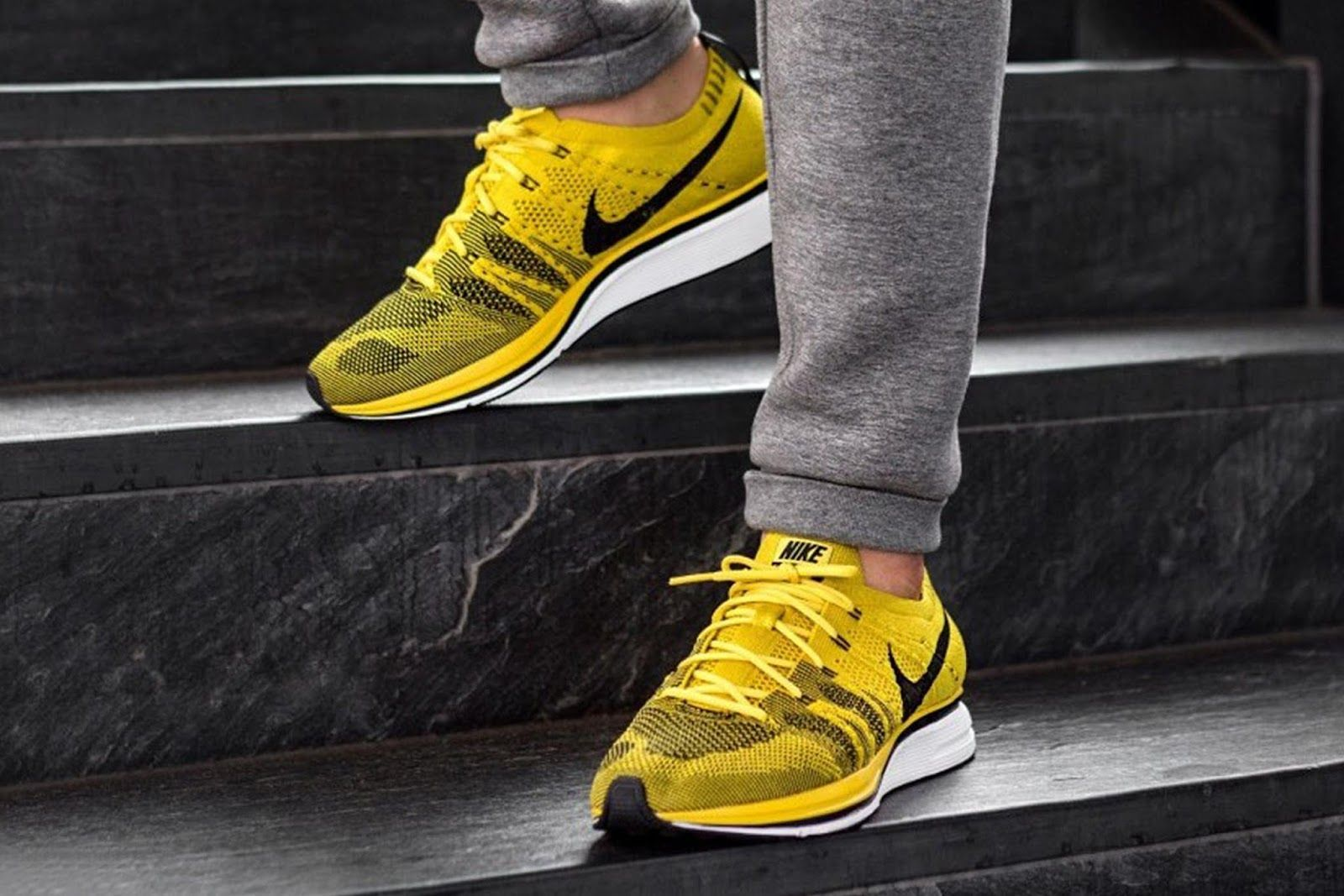 fbe135e4bae59c The Nike Flyknit Trainer Bright Citron comes dressed in a bright Yellow  Flyknit upper contrasted by the Black accents on the Swoosh