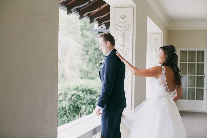 Montalvo Wedding Bride and Groom share their first look on the Balcony  Photo By Alexandra Wallace