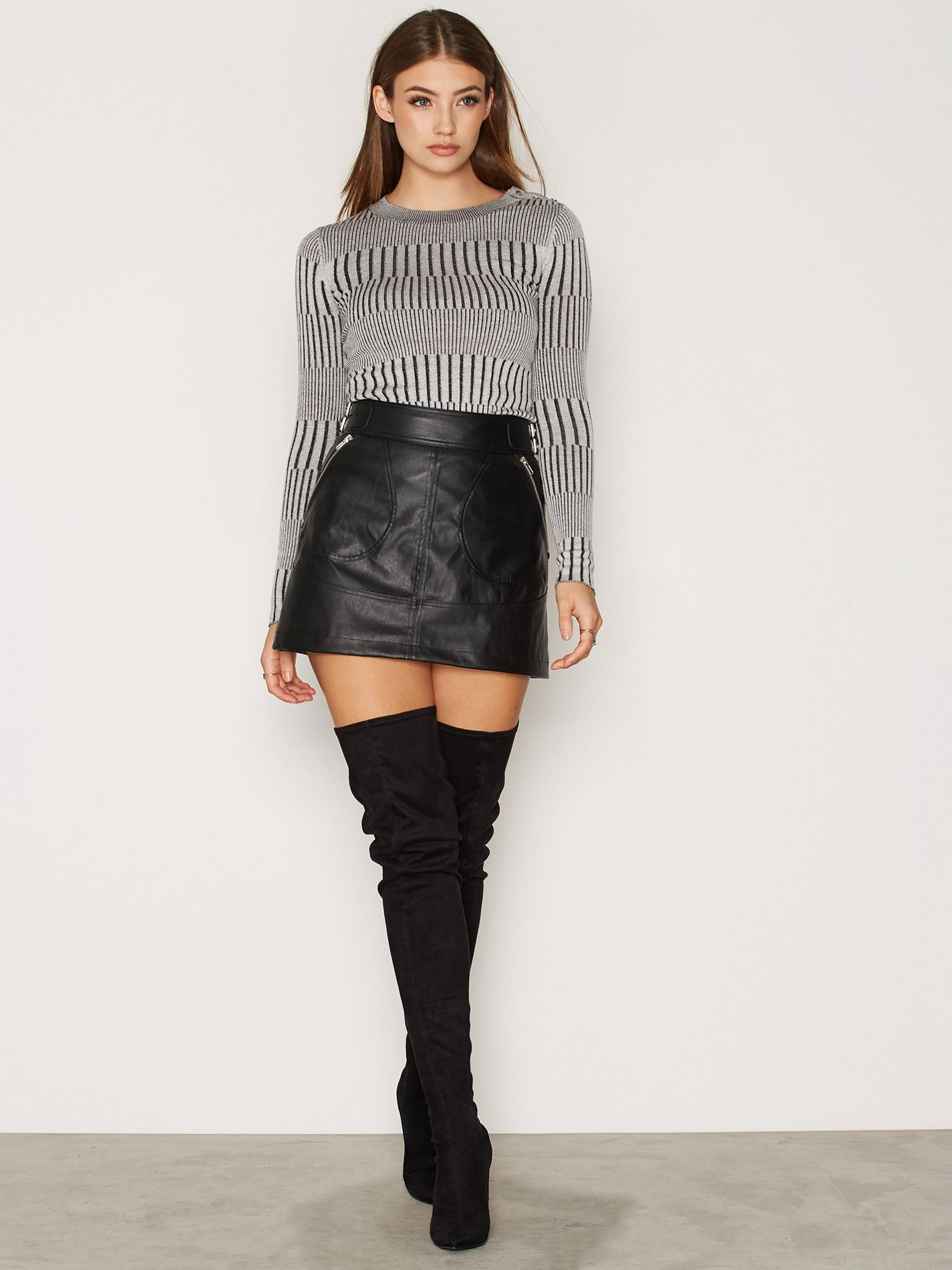 Black leather A-Line miniskirt and thigh boots   Leather mini skirts, Mini  skirts, Fashion