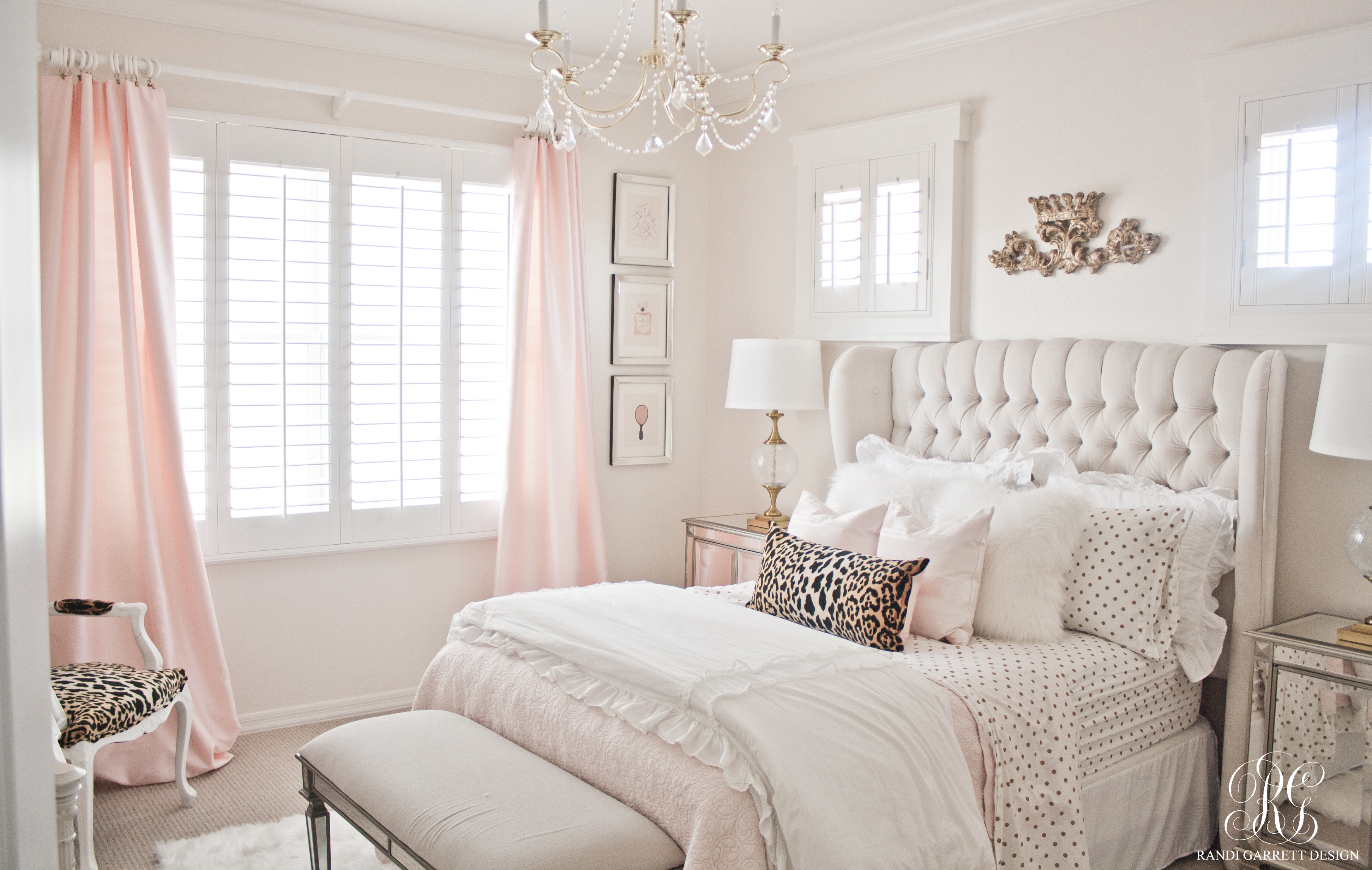 Pink and gold bedroom featuring tufted wingback
