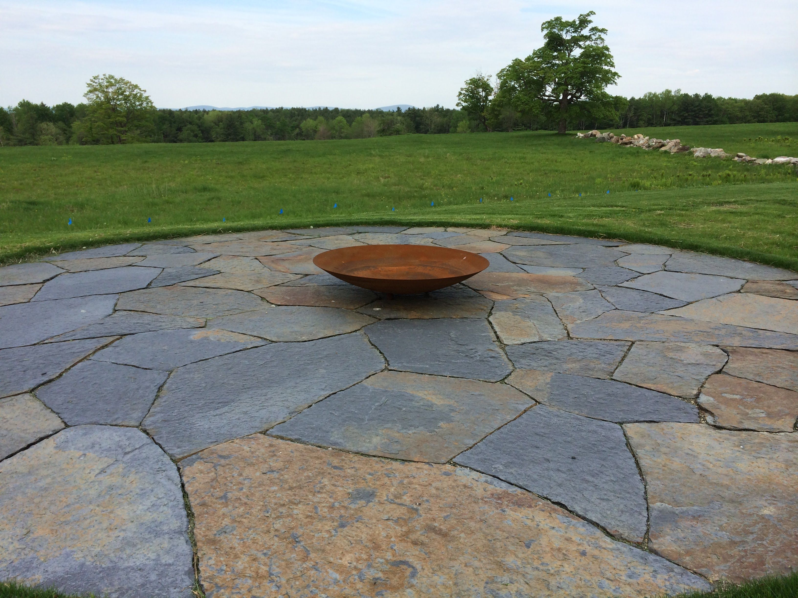 fire pit with 30 perfect circle of irregular goshen stone paving