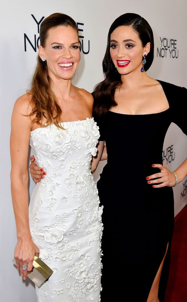 Cute co-stars! Hilary Swank and Emmy Rossum coordinate so well in these white and black ensembles!