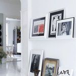 Stack your art sitting on the floor and on a picture ledge |10 Unconventional Ways to Hang Art | Apartment Therapy