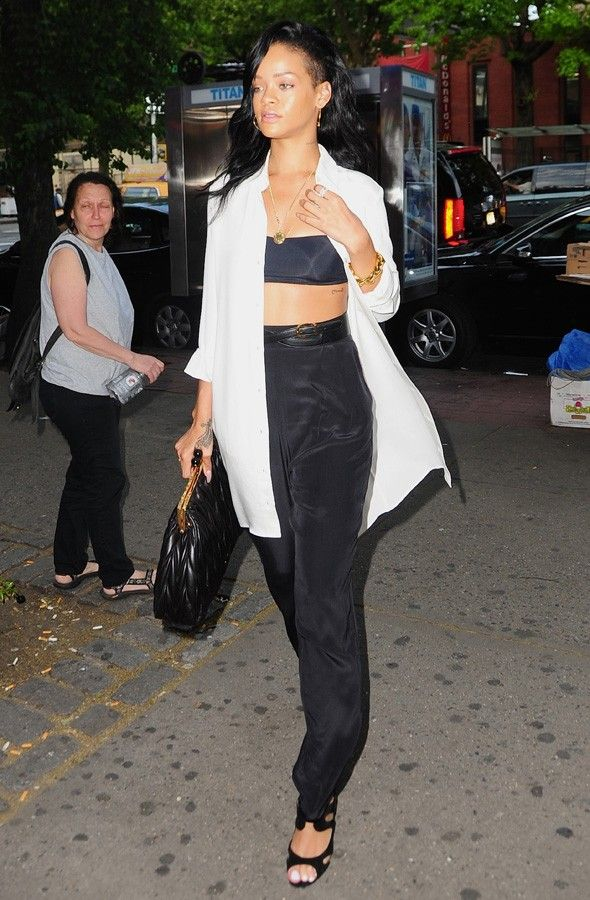 Rihanna out and about a few days ago in NYC.. not quite a crop top but it still does the trick!