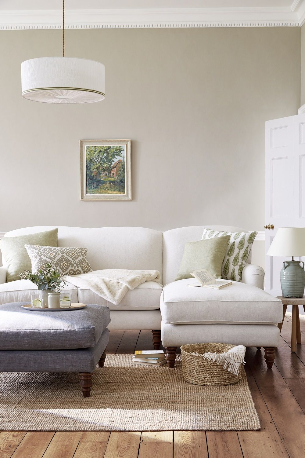 A Neutral Coloured Lounge Room With Light Beige Grey And Green