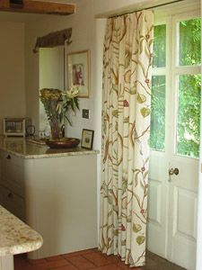 Door Curtain In Adamu0027s Eden Fabric, Well Suited To This Smart Country  Kitchen.