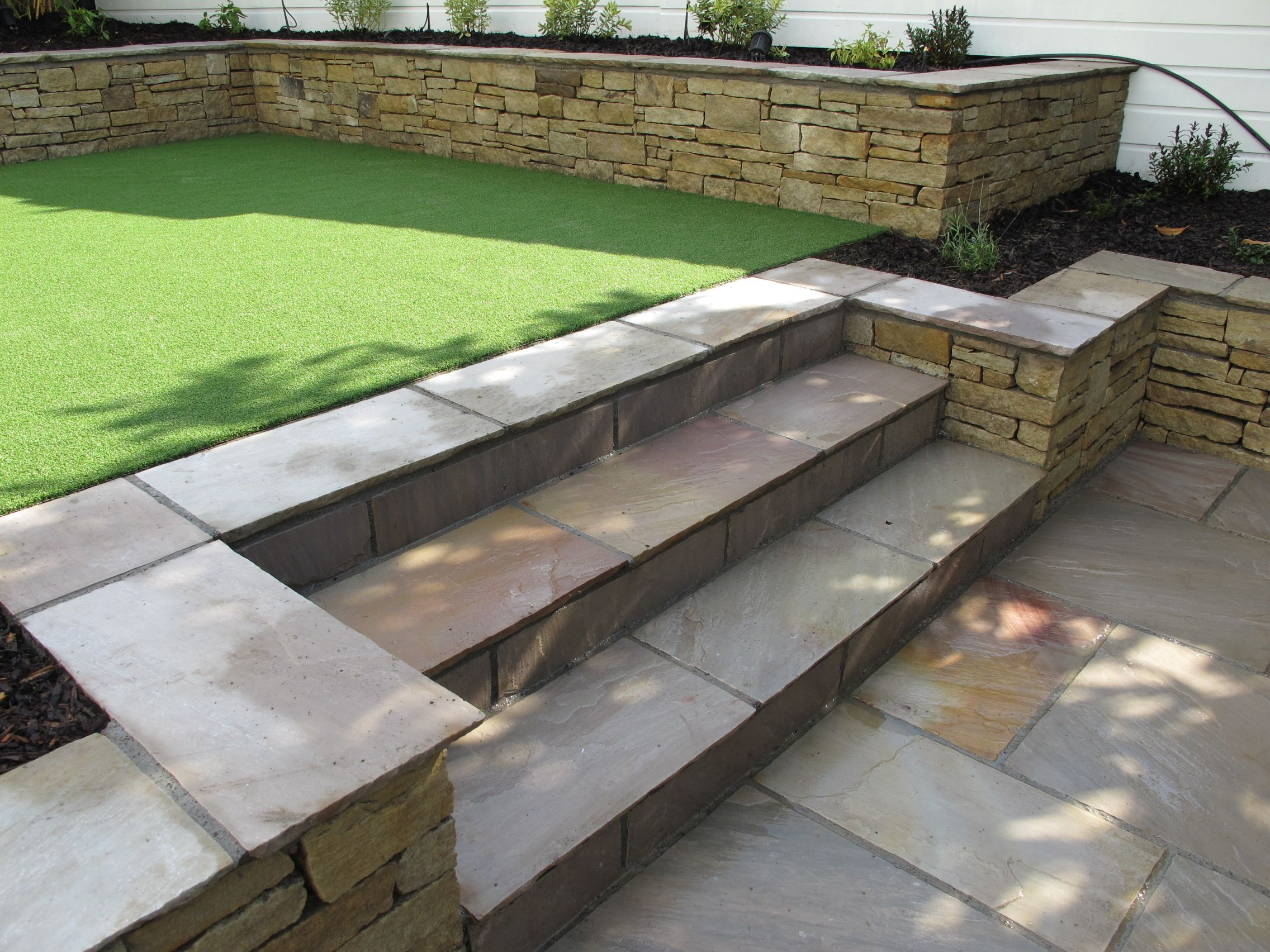Bon Split Level Low Maintenance Garden Scheme With Natural Sandstone Patios And  Raised Planters. Www.owenchubblandscapers.com We Design   We Build   We Care