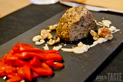 Marinated pork loin with blue cheese sauce at El Tap i Altres Terres in Valencia, Spain