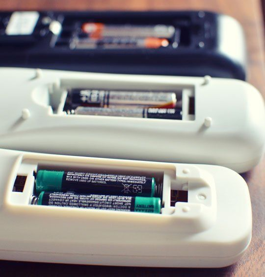 Q: I recently noticed several of my remote controls weren't working any longer, and when I opened them up to replace the batteries I found the batteries had leaked out battery acid. How do I clean the mess safely?