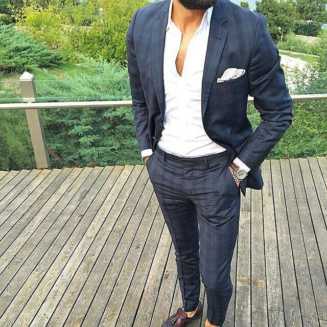 Mens Fashion. Suit jacket and unbuttoned white shirt.