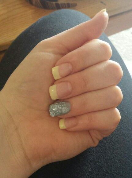 Pale yellow french tips and grey party finger with white flower stamp. May 2 2015.