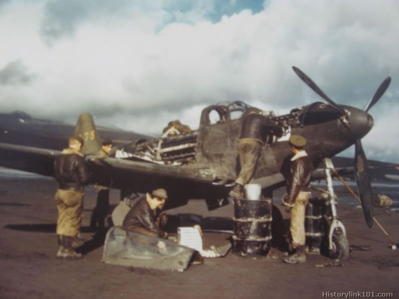 Maintenance crew repair a P-39 on an airfield in the Aleutian - free p&l template