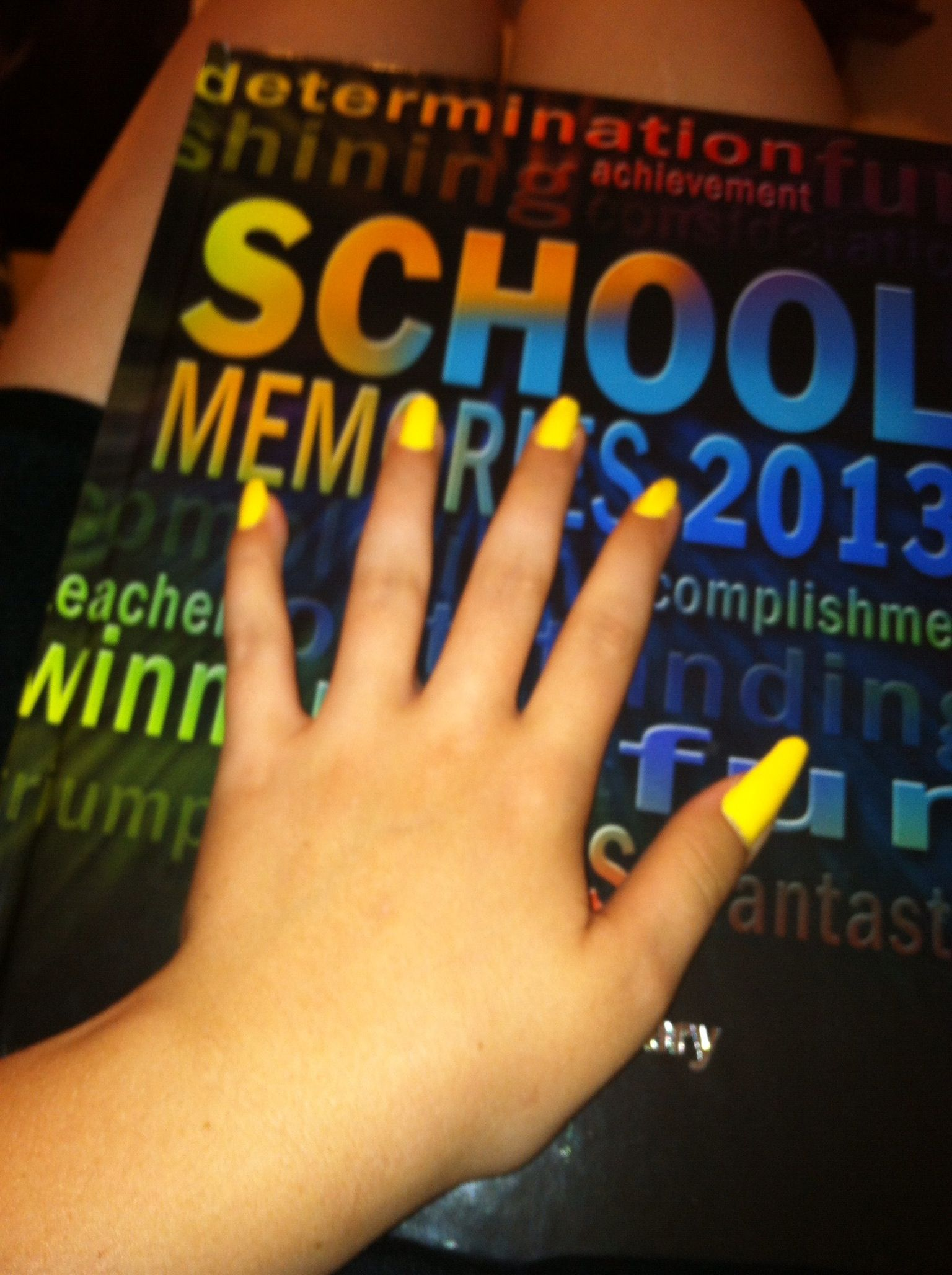 My nails painted lightning yellow and yes there real my nails