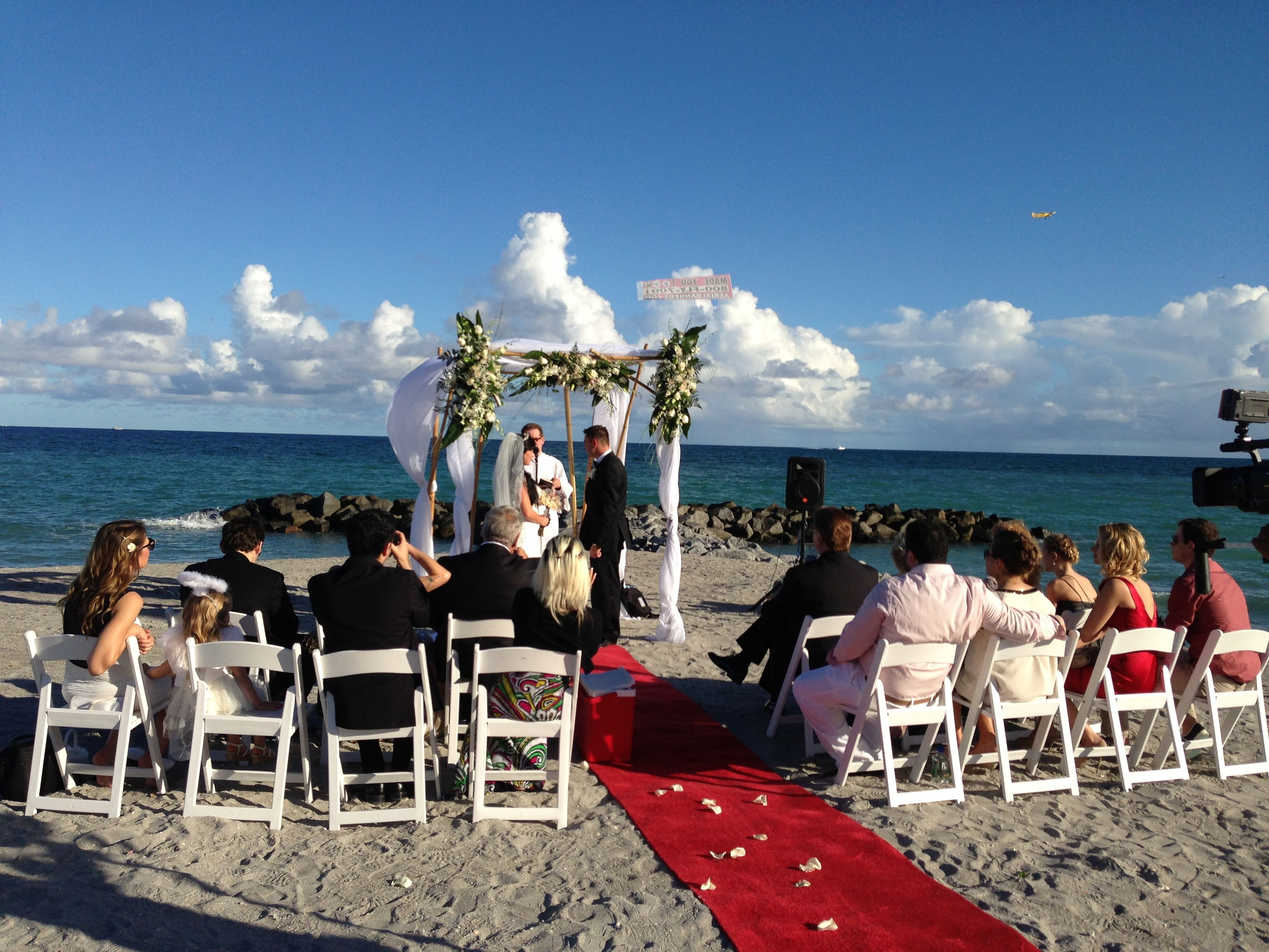Beach wedding setup Red carpet runner Gazebo Drape Flower
