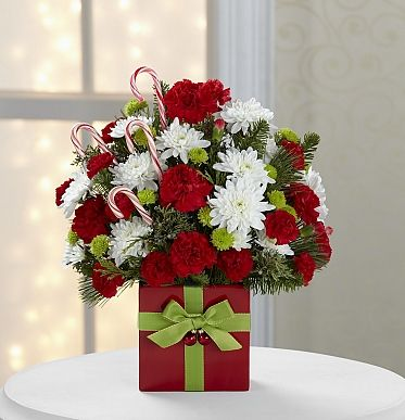 Christmas floral arrangement perfect for the Holidays! http://www.lebouquet.com/the-2013-ftd-holiday-cheer-bouquet