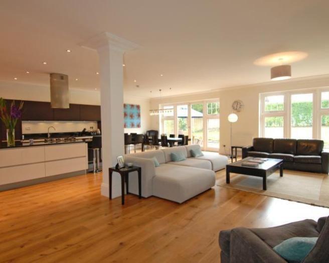 photo of open plan beige orange kitchen kitchen/diner lounge