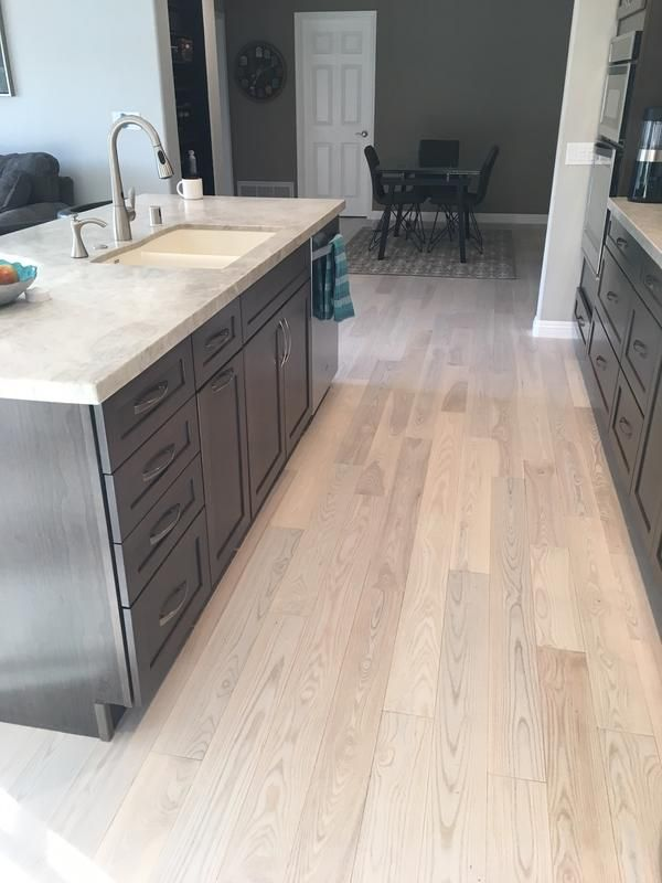 Want Something Light Bright Matte Finished Carriage House White Ash Is A Perfect Backdrop For This Kitchen Remodel Ash Wood Floor Hardwood In Kitchen Home