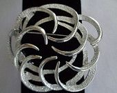 """20% off Coupon 512016 Sarah Coventry Art Deco Brushed Silvertone Brooch that is Round  and 3"""". Free Shipping to the United States. The price on this brooch which has matching earrings for sale in the store separately is $22.00 before you get your discount. Just use the coupon code 512016."""