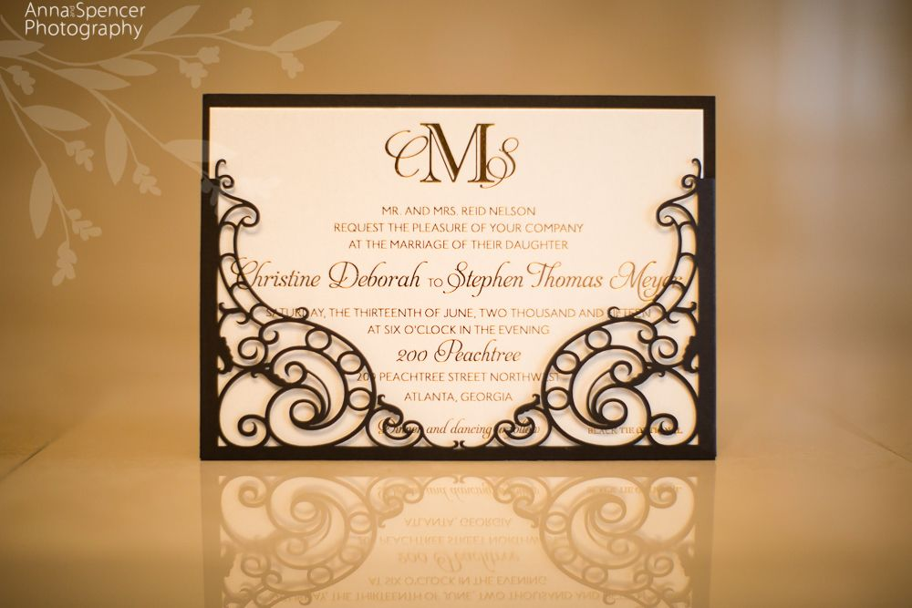 Laser cut black and gold wedding invitation