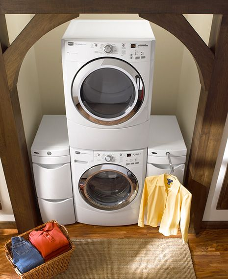 Maytag Front Loading Washer And Dryer Stacked On Top Of Each Other With Side Drawers Nearby You Can See The Pole Extended To Hold Clothes