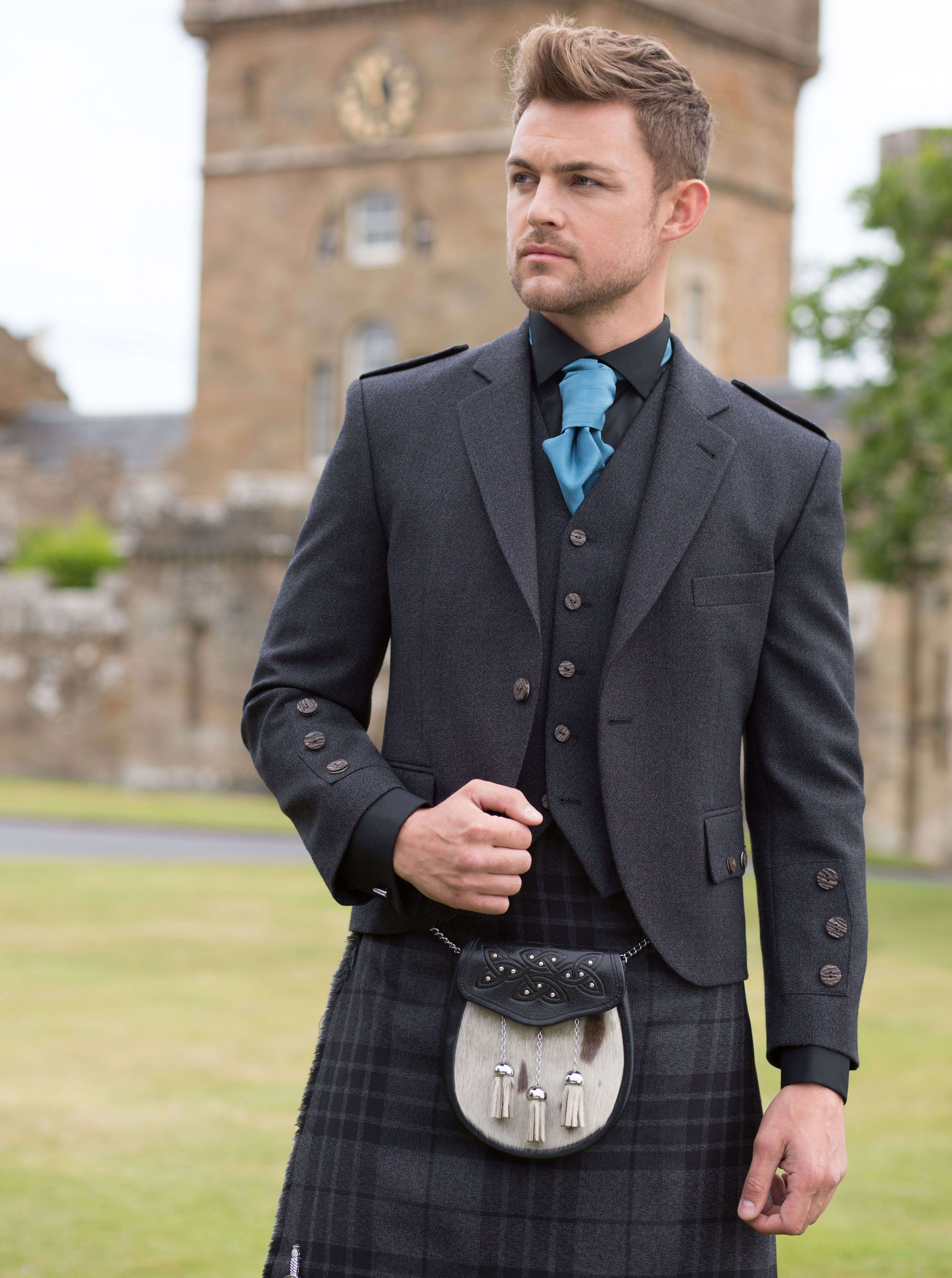Model Jordan Steel wearing the Grey Spirit tartan Kilt