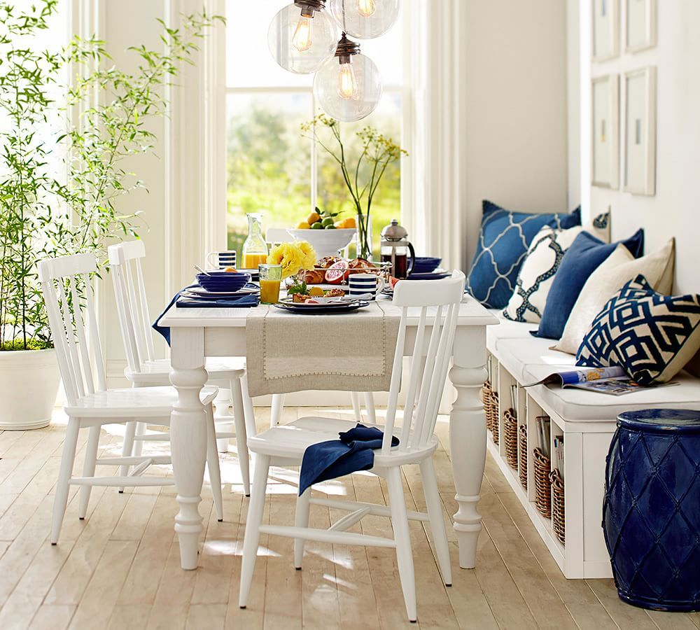 Think casual for small dining spaces a bench on the side for Small dining room storage ideas