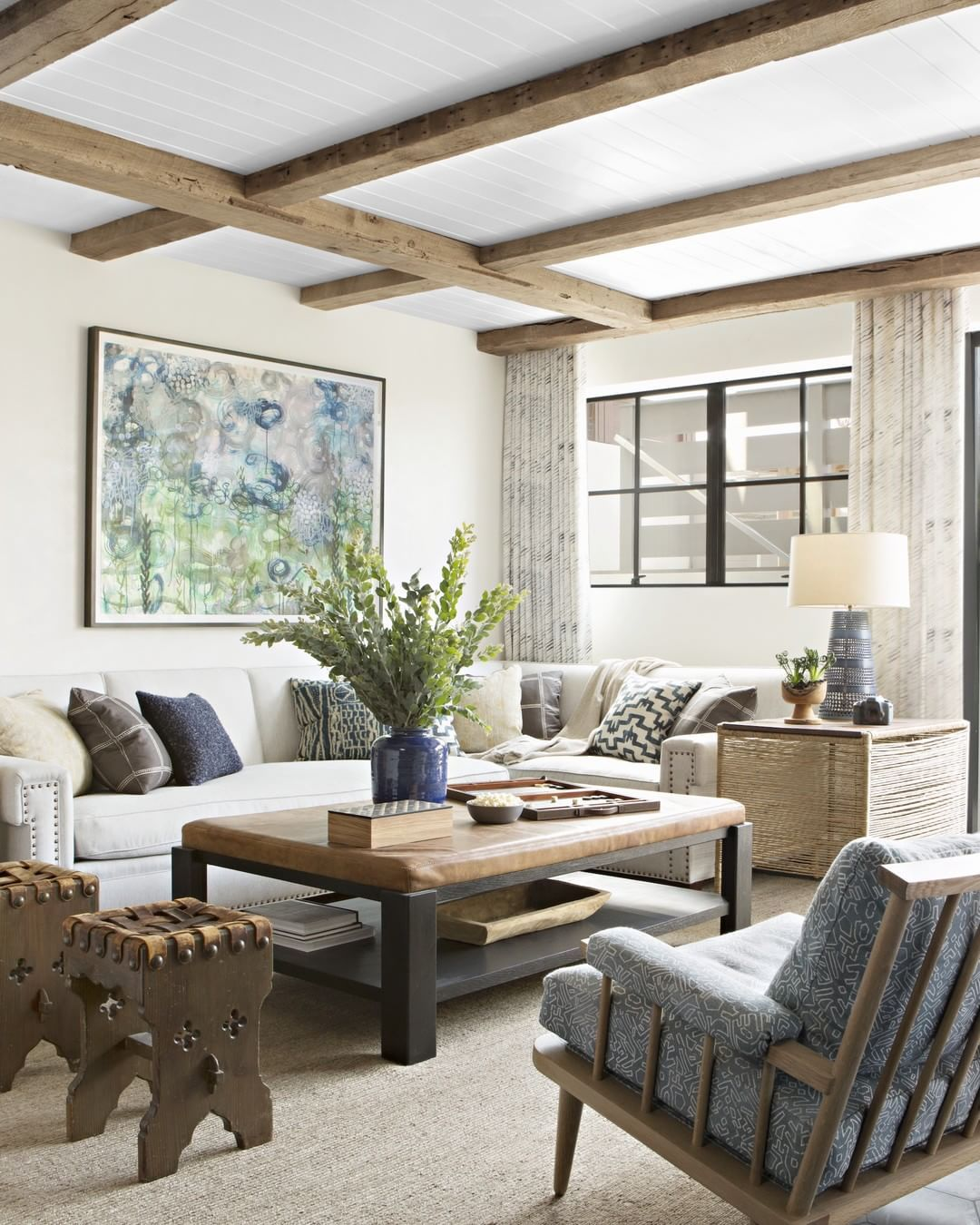 Beach chic living room with weathered wood ceiling beams and coastal ...