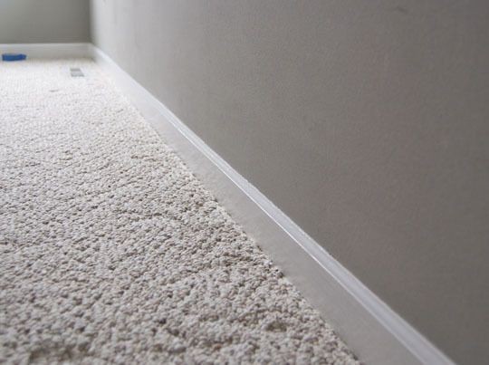 How To Paint Baseboards Next To Carpet The Packing Tape Trick Painting Baseboards Baseboards Home Improvement