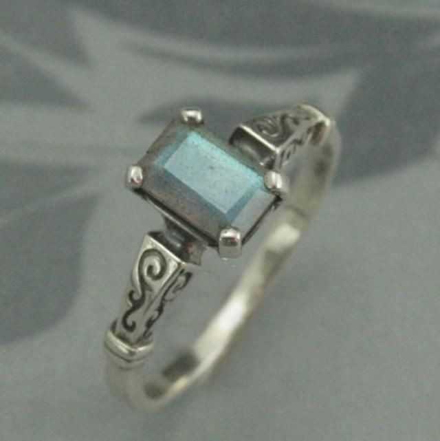 This stunning Sterling Silver ring is precast and set with a 7x5mm