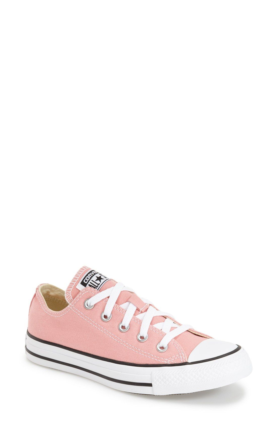 cca5a4e1842 Adding a sweet touch to the classic Converse low top sneaker by making them  pink. Can t wait to add these to the collection!