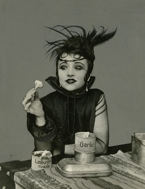 Stage and silent film actress Valeska Suratt eating garlic and limburger cheese. (I'd kiss her anyway!)