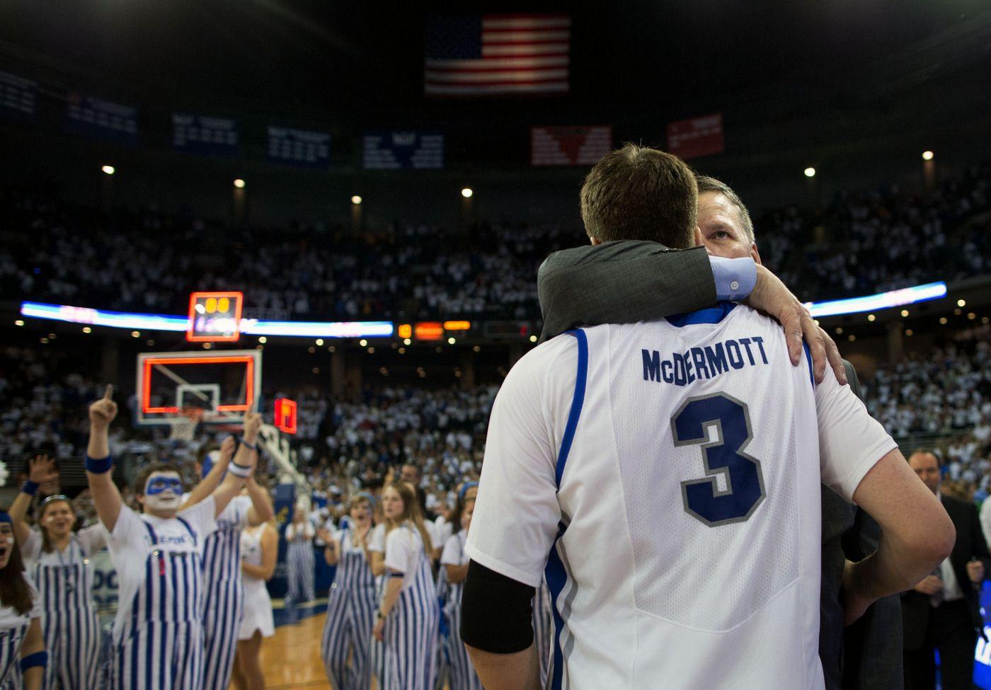 CU head coach Greg McDermott embraces his son, Doug