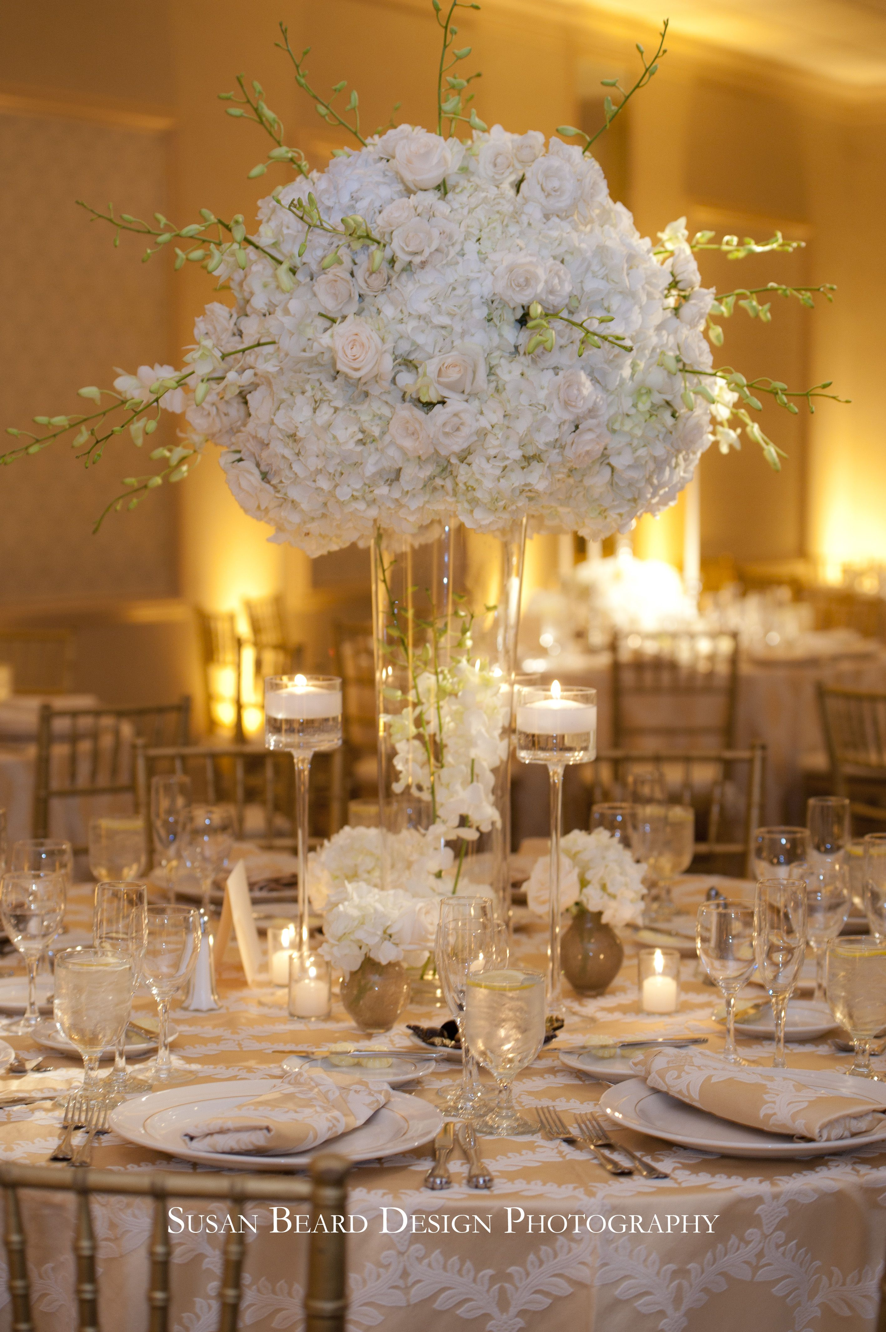 White hydrangea white roses and white orchids