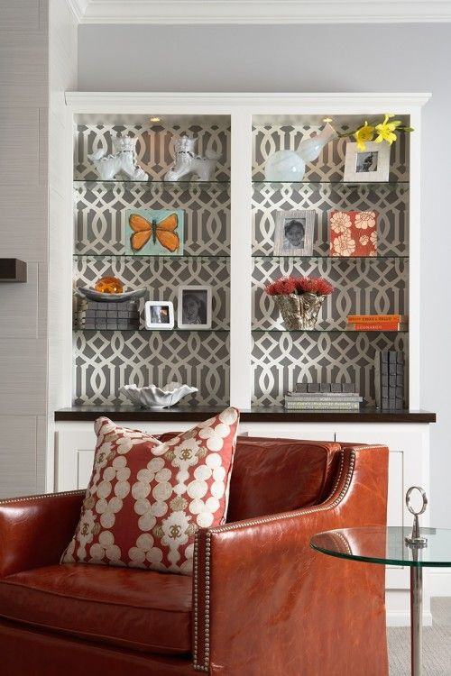 bookcases with wallpaper backing