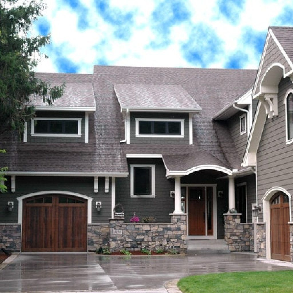 Grey also white painting combination for craftsman house among wooden arch doors and jagged stone walls